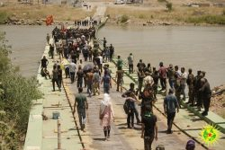 Marching on the Iraqi border with the Kurdish Youth Movement